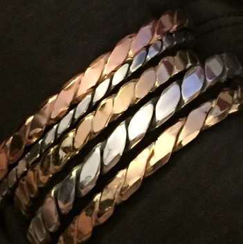 Twisted Cuffs  - sterling silver, and yellow and pink gold-filled, by Roni Bader-Tables