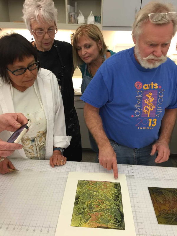 Glory Tacheenie-Campoy printing with Dan Welden and APG members Marlys Kubicek and APG President Paulette Olive