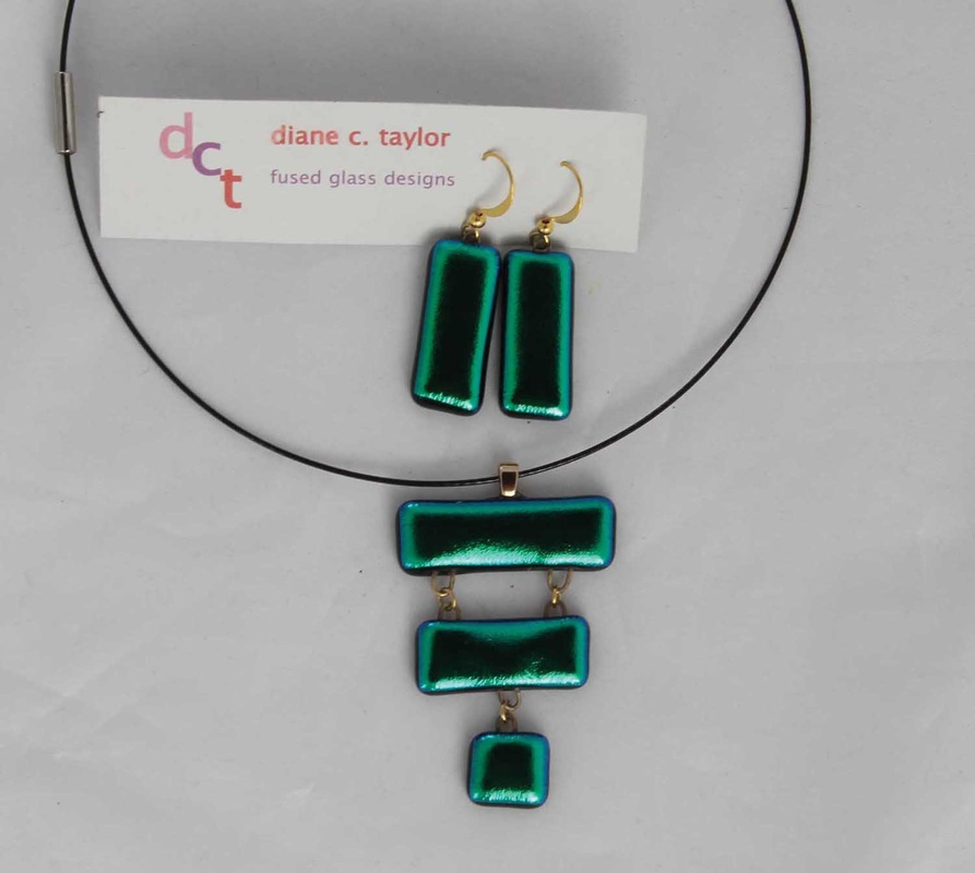 Green dichroic pendant and earrings, by  Diane C. Taylor